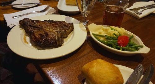 The monstrosity that is Vieux Port Steakhouse Porterhouse.  So big it requires it's own plate!