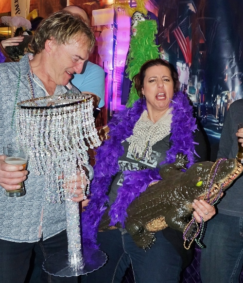 Tom McGouran lampshade at the ready with Alix Michaels rocking out with an Aligator at Mardi Gras Media Night